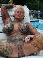 Heavily Tattooed Mature MILF Shows Off At Rally